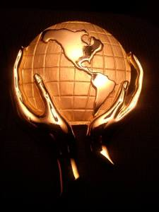 Gold Hands Holding Earth Globe UG fb URL 68664_10201569083943188_824239990_n