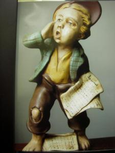 Newspaper Boy shoeless hole in pants UG fb URL 526259_3473296165376_1746232967_n